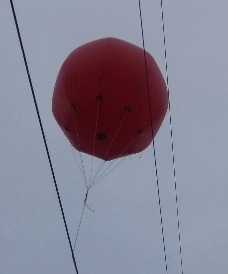 balloon caught in power lines