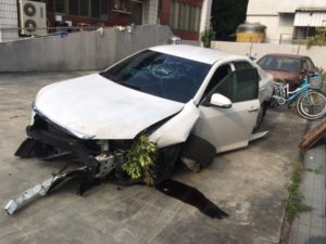 car after rear-ending motorcycle.