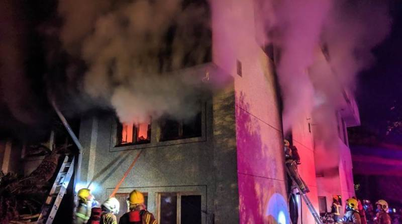 a fire engulfs a building housing members of a Buddhist commune in Tainan City
