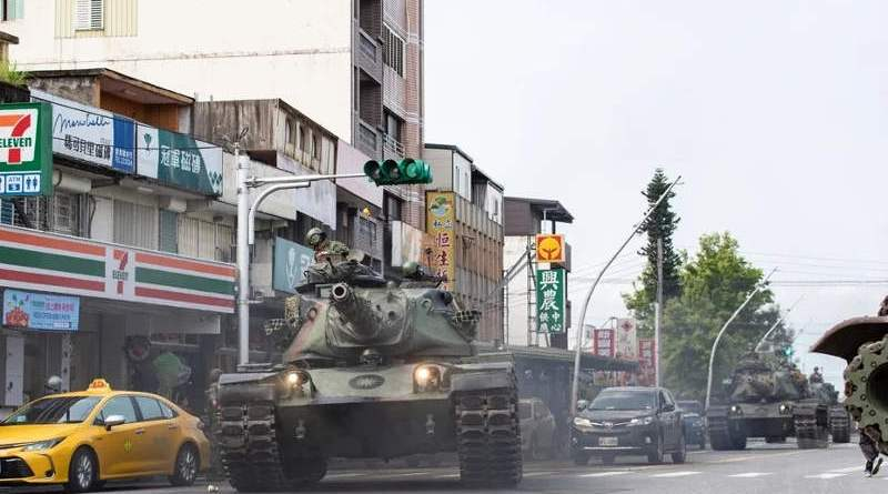 Tanks rumble down a street in Yilan County, March 25, 2020