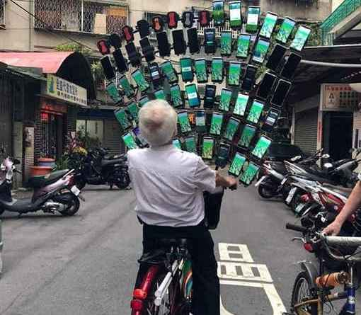 Taiwan's Pokemon Go grandpa with array of 64 phones
