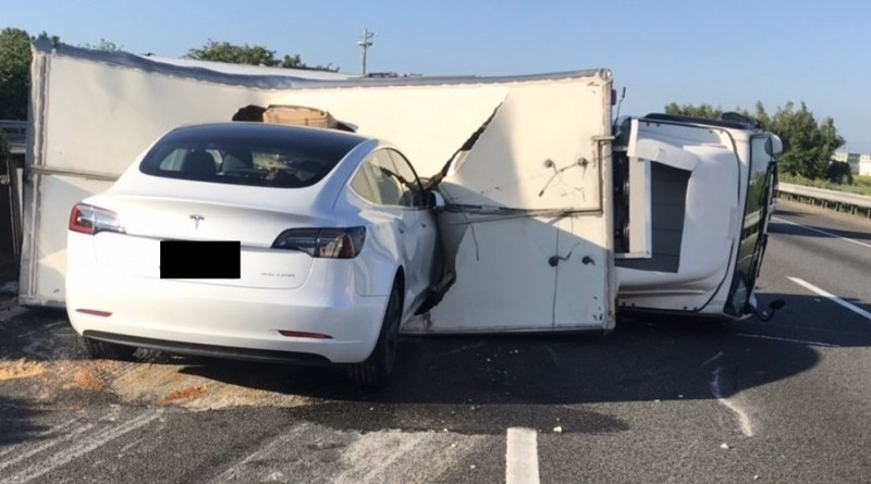 Tesla crashed into roof of overturned truck