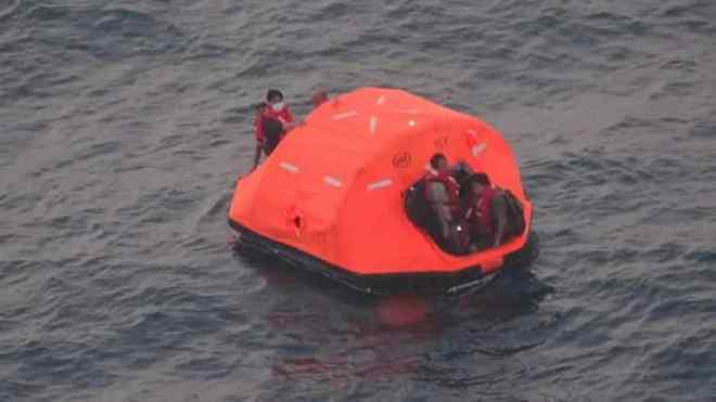 crew of freighter in life raft