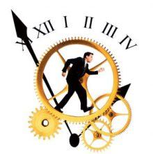 Businessman running on clock gears