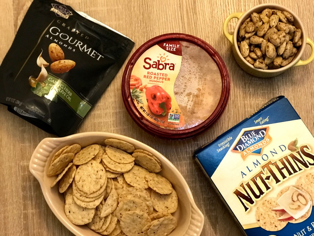 Sabra Roasted Red Pepper Hummus, Blue Diamond Nut-Thins, Blue Diamond Gourmet Garlic, and Herb Olive Oil Almonds