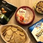 Sabra Roasted Red Pepper Hummus, Blue Diamond Nut-Thins, Blue Diamond Gourmet Garlic, and Herb Olive Oil Almonds