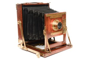 A photo of a vintage wooden camera