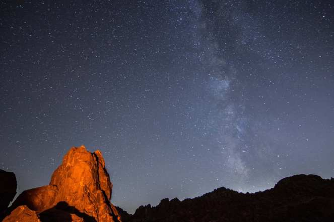 Milky Way galaxy stars starry mountain rock formation