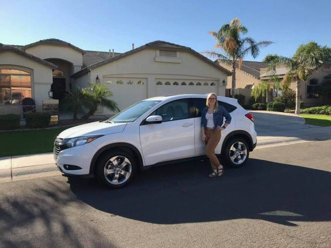 The author poses with her white Honda HR-V