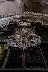 bird pecks human skull schwarzenburg family crest Sedlec Ossuary