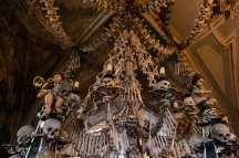 bone chandelier skulls bones cherubs candles warm color tones