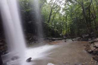 Water explodes outwards away from the bottom of Cucumber Falls in Ohiopyle State Park