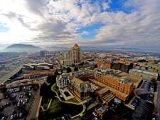 Aerial photo of Roanoke VA with blue ridge mountains in the background