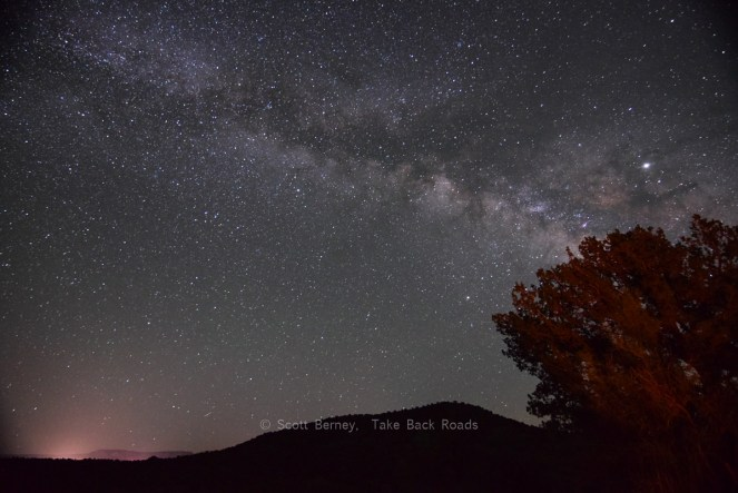 Night sky photo apps.  The Milky Way stretches across the dark night sky over the glow from the lights in Sedona, Arizona, surrounded by hundreds of other stars.