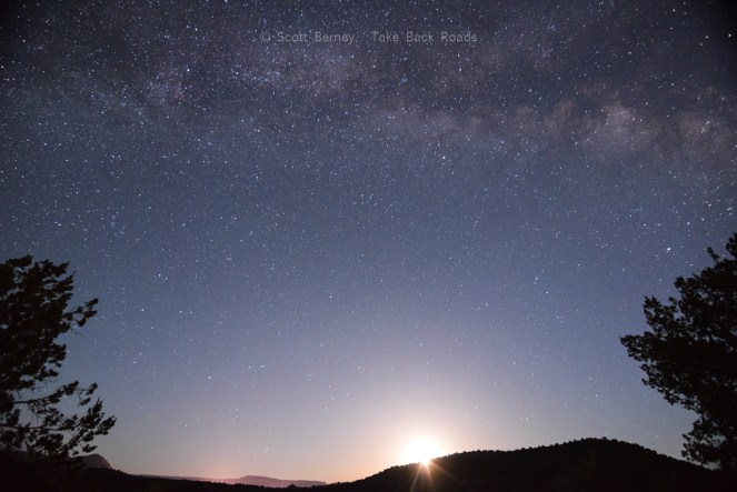 Long exposure night sky photograph of moon rise and the Milky Way. Learn what equipment you need to take photos of the night sky.