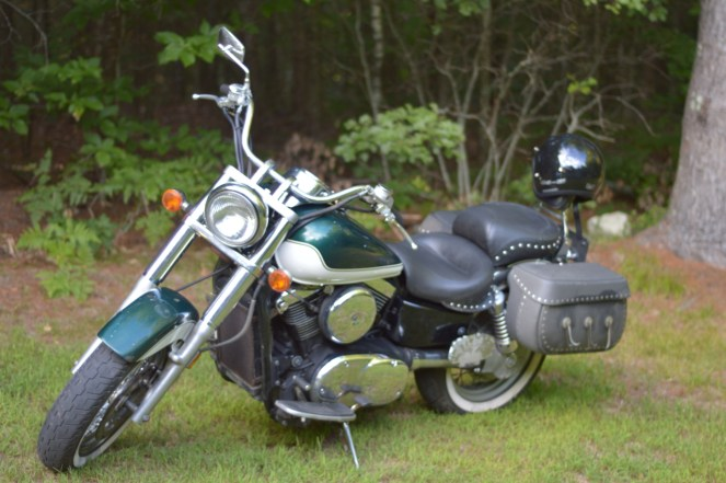 Green Kawasaki Vulcan Classic motorcycle, photographed to show off the motorcycle primary cover