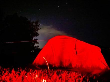 Tent under night sky at Iowa Falls campsite