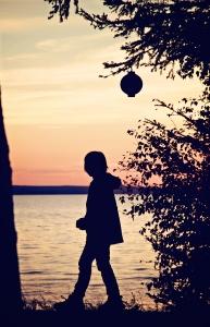 little-boy-walking-by-a-lantern-1438828-m
