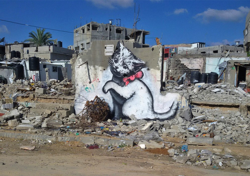 A local man came up and said 'Please - what does this mean?' I explained I wanted to highlight the destruction in Gaza by posting photos on my website – but on the internet people only look at pictures of kittens.