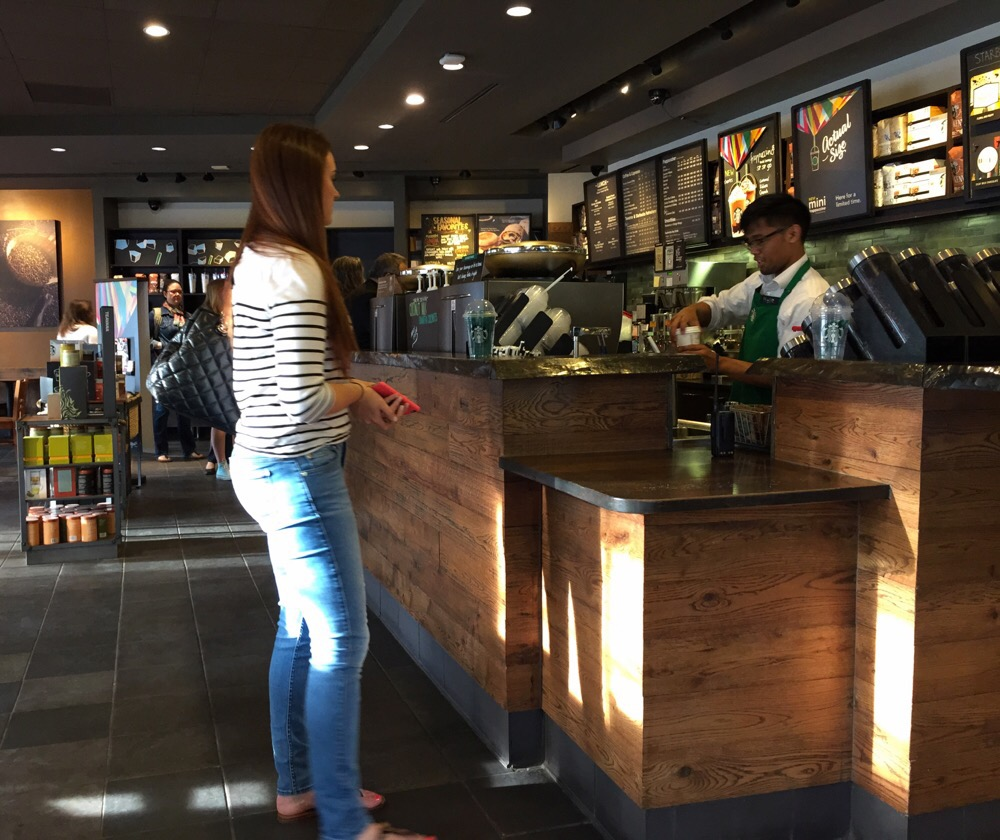 Serving coffee at Starbucks on Wisconsin Ave in Bethesda, Maryland