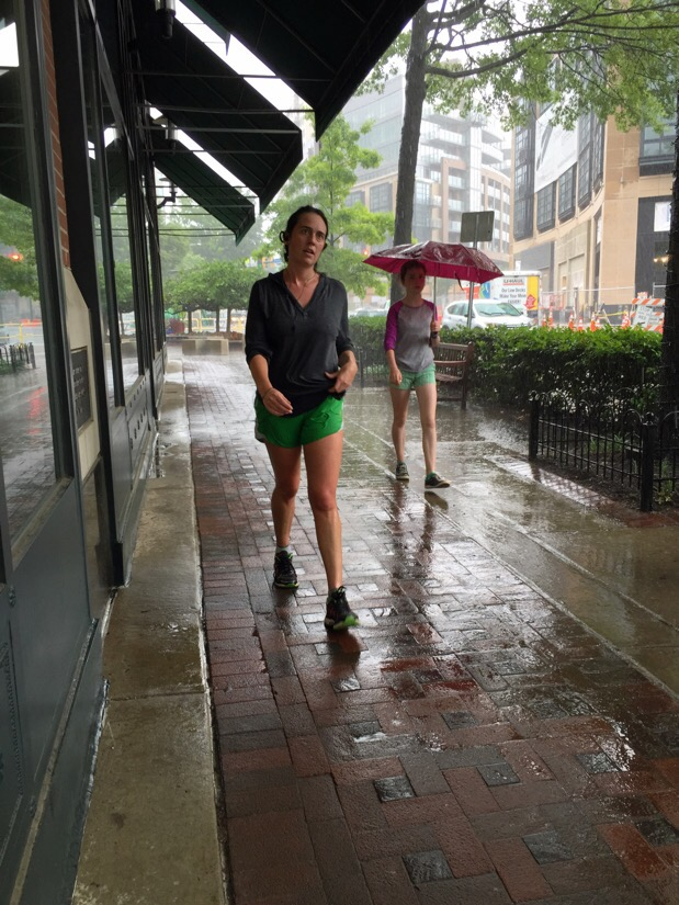 two women working during a rain storm in bethesda, maryland