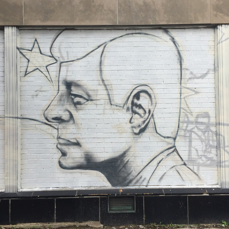 street mural of resident kennedy on wisconsin ave, nw in washington dc