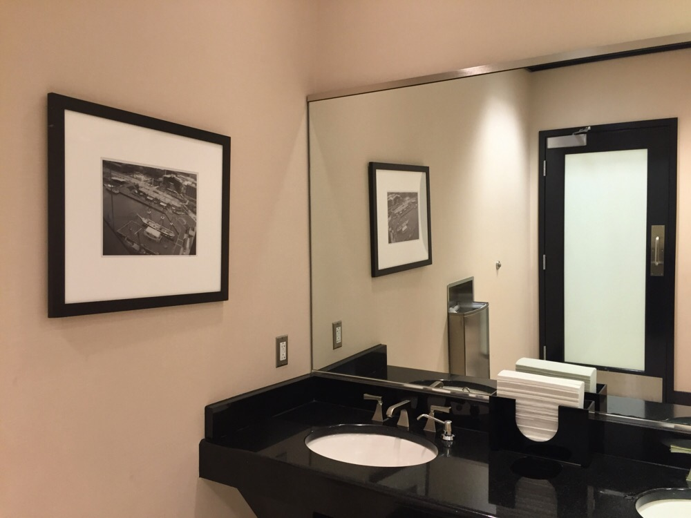 photographs displayed in the mens restroom in the mens restroom in the bloomingdales store in chevy chase, md