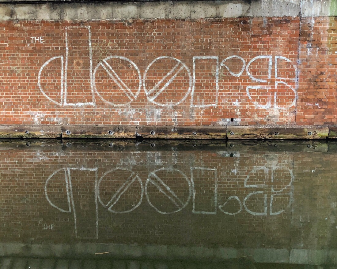 Graffiti art on the side of the Leeds Liverpool canal in Liverpool, uk