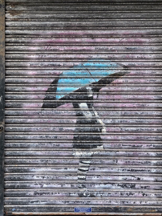 Person with umbrella street art in Southport
