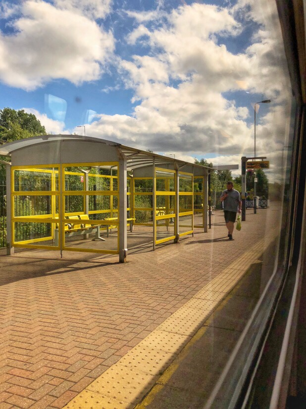 Through the window of a merseyrail train heading towards central Liverpool