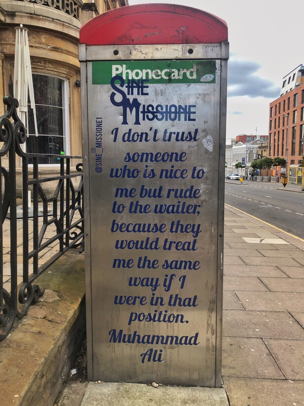 Inspirational messages on telephone boxes from Sine Missione in Liverpool, England