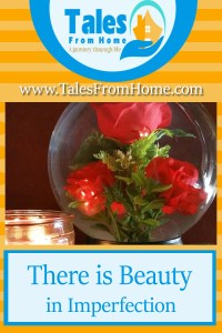a picture of a rose globe and a candle.