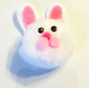 a pom pom bunny decoration as part of an Easter crafts post