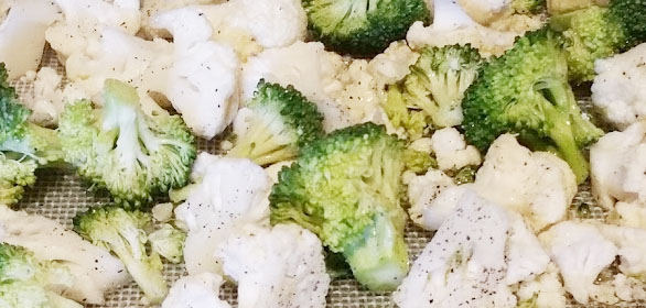 Broccoli and cauliflower tossed in oil,salt and pepper