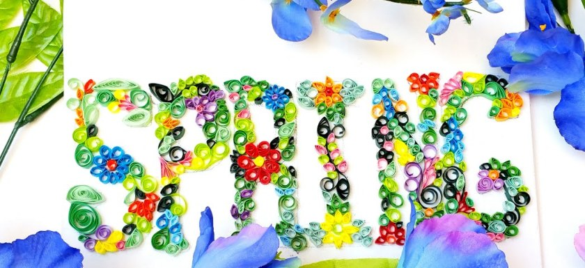 A quilled sign which reads 'Spring""