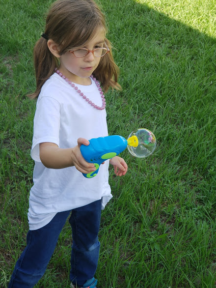 child with bubbles, your almost free summer of fun