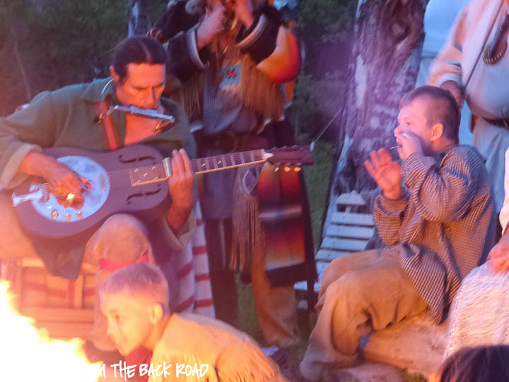 Harry Harpoon playing music atCamp Henry mountain man rendezvous