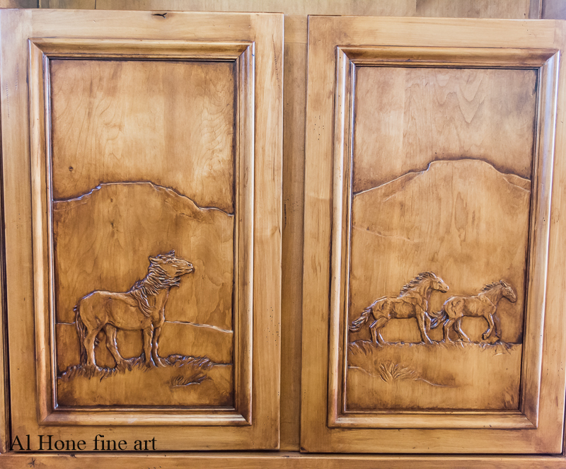 Custom carved bookcase with horses