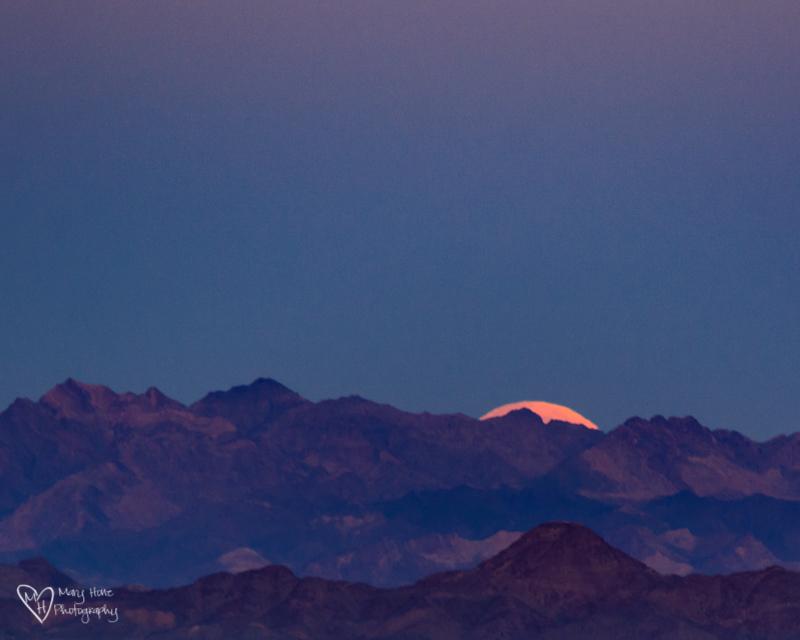 Good Night Moon, full moon setting in the desert