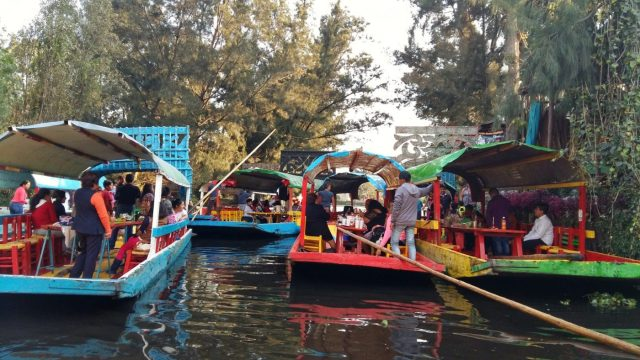Boats fight for space on the river during busy times at Xochimilco