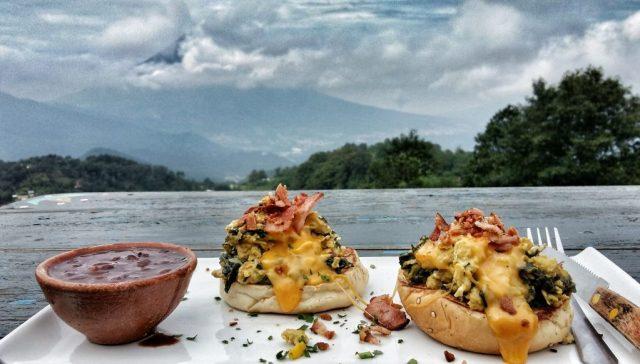 A tasty breakfast of Dragon's Eggs Florentine, overlooking the valley in Hobbitenango Antigua Guatemala
