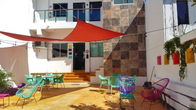 The downstairs terrace & entrance to the Mermaid Hostel Beach Cancun