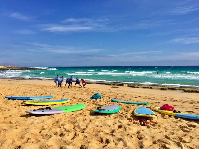 Warming up on the beach before our surf class in Fuerteventura with Planet Surf Camp