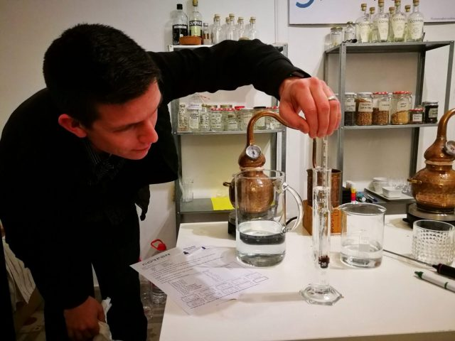 Brian showing how to measure the alcohol content and temperature of our homemade gin
