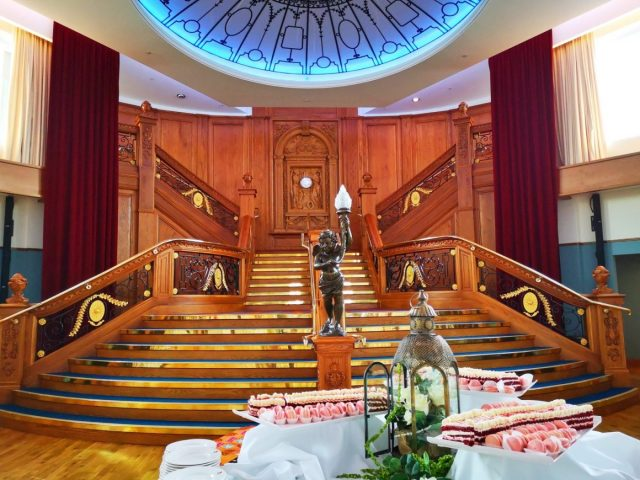 The Grand Staircase and Cutting Cake at the Titanic Museum Belfast - afternoon tea in Belfast