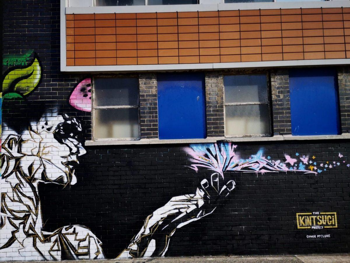 Belfast Street Art - A portrait on a dark background