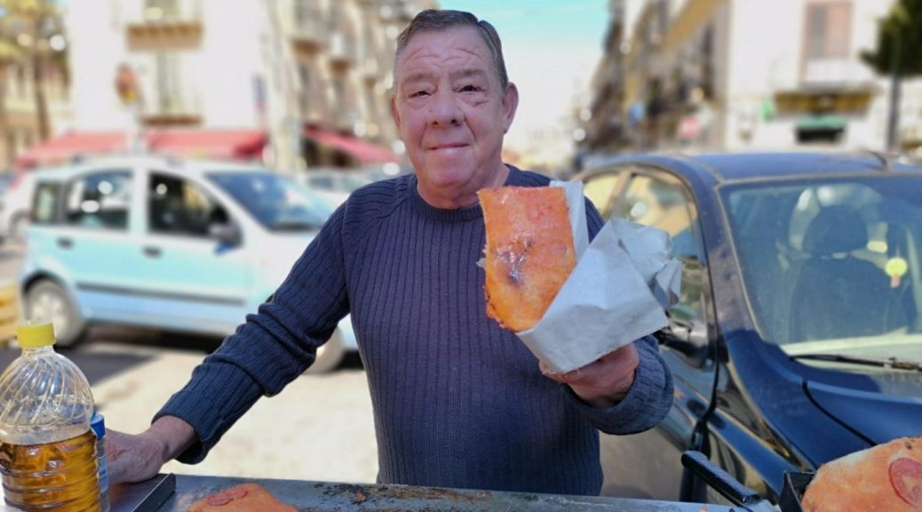 The Sfincione Pizza Seller in the Mercato del Capo Palermo