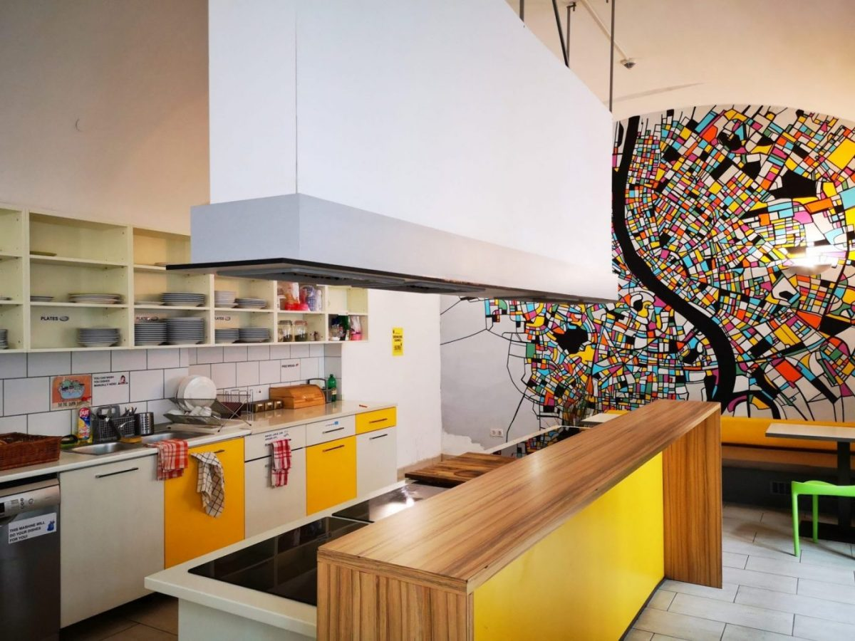 A colourful and clean hostel kitchen at wombat's Hostel in Budapest