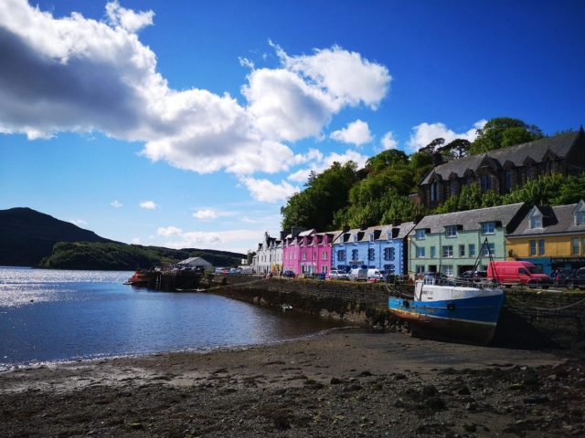 Pretty Portree with Colourful Houses in the bay with a boat