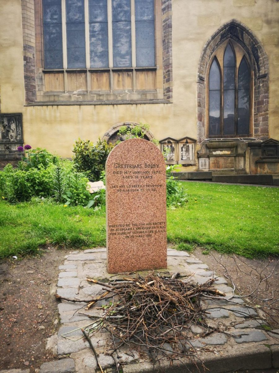 The Grave of Greyfriars Bobby in Greyfriars Kirkyard with Sticks in front of it